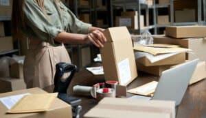 female small business owner packing ecommerce orde 2021 05 05 22 22 14 utc