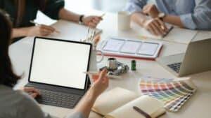 graphic designer team uses laptops to design new p 5T7QC88