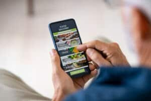 man using mobile app to order delivery food 2021 04 03 19 39 40 utc