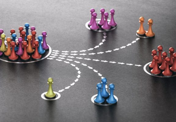 3D illustration of many pawns segmented in different categories over black background. concept of customer segmentation.