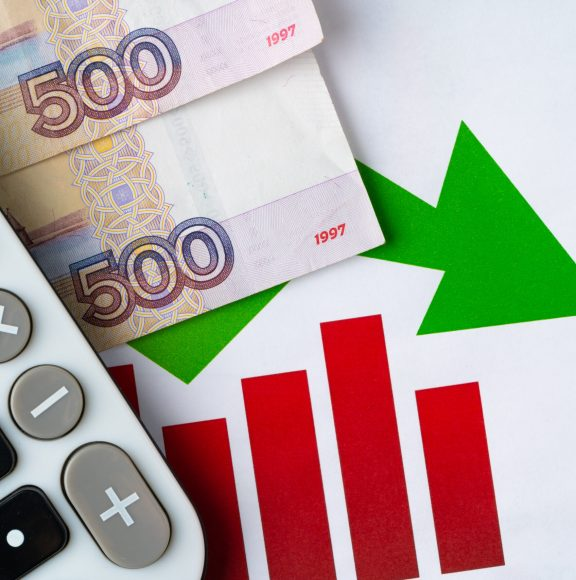 Financial chart with Russian rubles money stack with calculator. Currency appreciation concept. High quality photo