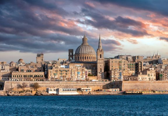 Valletta, Malta, Skyline in the afternoon with the dome of the Carmelite Church and the tower of St Paul`s, cloudy sky background